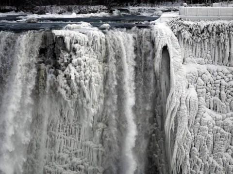 Niagara Falls frozen in time as Polar Vortex blankets US