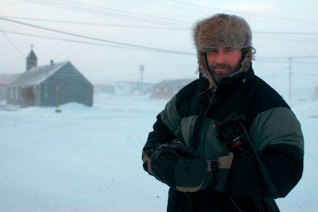 Body heat: Dan O'Brien in the Arctic Circle, where he stayed with Pulitzer Prize-winning photojournalist Paul Watson (Picture: Paul Watson)