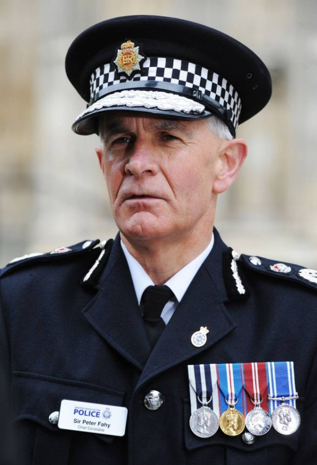 "File photo dated 30/09/12 of Greater Manchester Police Chief Constable Sir Peter Fahy who will be charged with a health and safety breach over the shooting of an unarmed man. PRESS ASSOCIATION Photo. Issue date: Thursday January 16, 2014. He is accused of failing to discharge a duty under the Health and Safety at Work Act as he is ""corporation sole"" for the force, the Crown Prosecution Service said. This is a legal status and means that he does not share criminal liability or will personally have to appear in court. See PA story POLICE Grainger. Photo credit should read: Anna Gowthorpe/PA Wire"