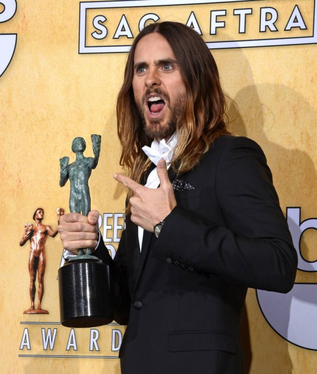 epa04029486 US actor and singer Jared Leto holds the award for 'Outstanding Performance by a Male Actor in a Supporting Role' in 'Dallas Buyers Club' at the 20th Annual Screen Actors Guild Awards at the Shrine Auditorium in Los Angeles, California, USA, 18 January 2014.  EPA/PAUL BUCK