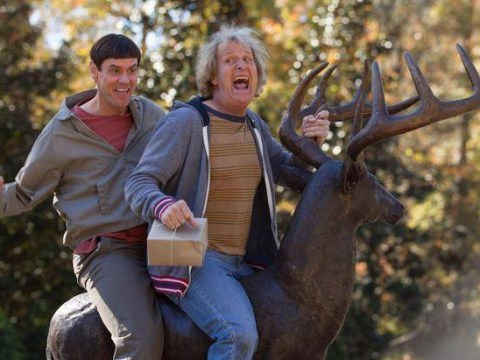 Jim Carrey and Jeff Daniels mess around on stag statue in first official Dumb and Dumber To picture