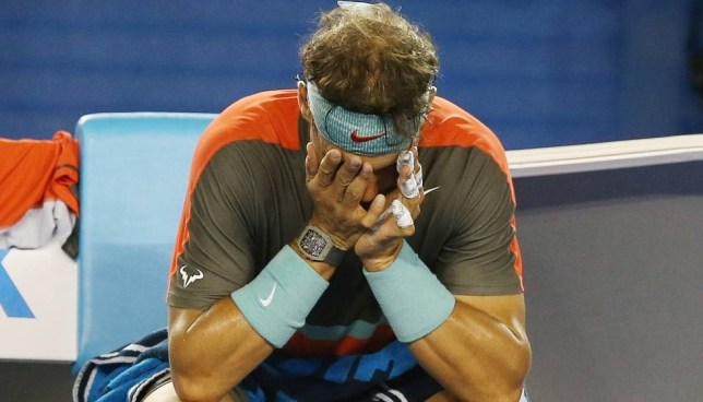 Tennis - Australian Open - Melbourne Park, Australia - 26/1/14  Men's Singles - Spain's Rafael Nadal looks dejected after sustaining an injury during the final  Mandatory Credit: Action Images / Jason O'Brien  Livepic  EDITORIAL USE ONLY.
