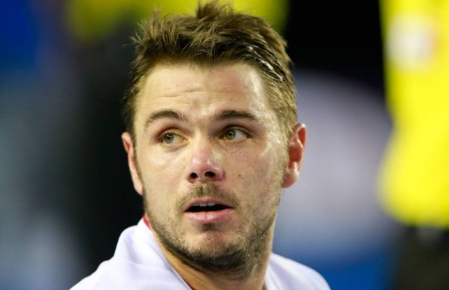 MELBOURNE, AUSTRALIA - JANUARY 26:  Stanislas Wawrinka of Switzerland looks on in his men's final match against Rafael Nadal of Spain during day 14 of the 2014 Australian Open at Melbourne Park on January 26, 2014 in Melbourne, Australia.  (Photo by Scott Barbour/Getty Images)
