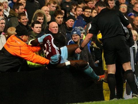 Chelsea v West Ham: Watch Mohamed Diame injure himself as he smashes into the crowd at Stamford Bridge