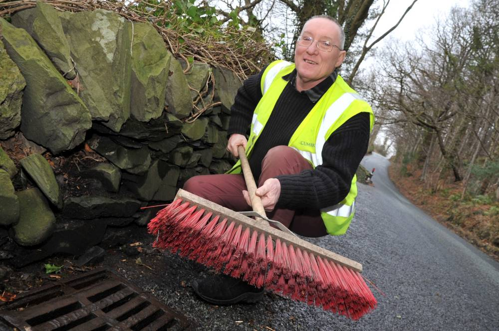 FROM JOHN JEFFAY AT CASCADE NEWS LTD    0161 660 8087 /  07771 957773  john@cascadenews.co.uk Syndicated for Westmorland Gazette Archie Workman Drain covers in Archie Workman's calendar.  Also features some of the grass verges  he looks after in his job THE dullest calendar of 2014 features a selection of  . . . DRAIN COVERS. Forget firemen, rugby players or Womenís Institute members - Archie Workman hopes to wow punters with a dozen of his most fascinating images. Heís catalogued some of his favourite drain covers in his job as a temporary lengthsman, maintaining ditches and roadsides for Colton Parish Council, in Cumbria. Archie, of Penny Bridge, Ulverston, Cumbria, originally put together six of the calendars for his colleagues. But inquiries have now come in from all over the country and there have been requests for 60 of the calendars, which sell for £13.