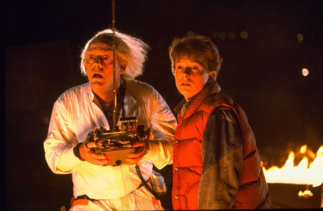 Film: Back to the Future (1985)  Shown from left: Christopher Lloyd (as Dr. Emmett Brown), Michael J. Fox (as Marty McFly) Directed by Robert Zemeckis
