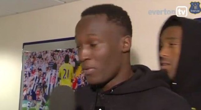 Romelu Lukaku gets his hat pinched by Sylvain Distin (Picture: Everton TV)