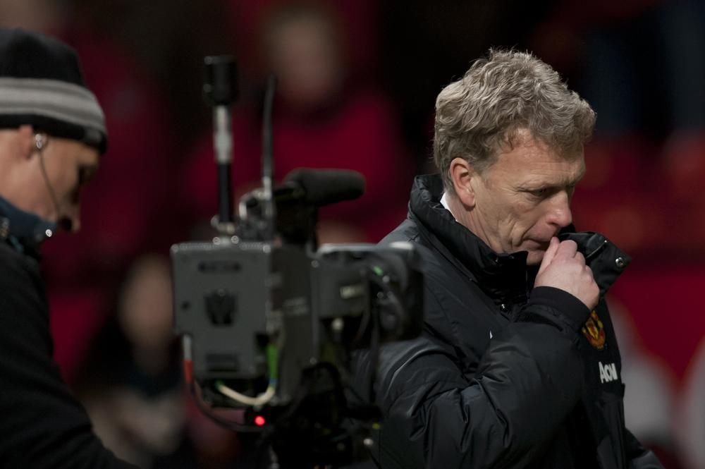 Manchester United's manager David Moyes walks from the pitch after his team's 2-2 draw against Fulham in their English Premier League soccer match at Old Trafford Stadium, Manchester, England, Sunday Feb. 9, 2014. (AP Photo/Jon Super) AP Photo/Jon Super