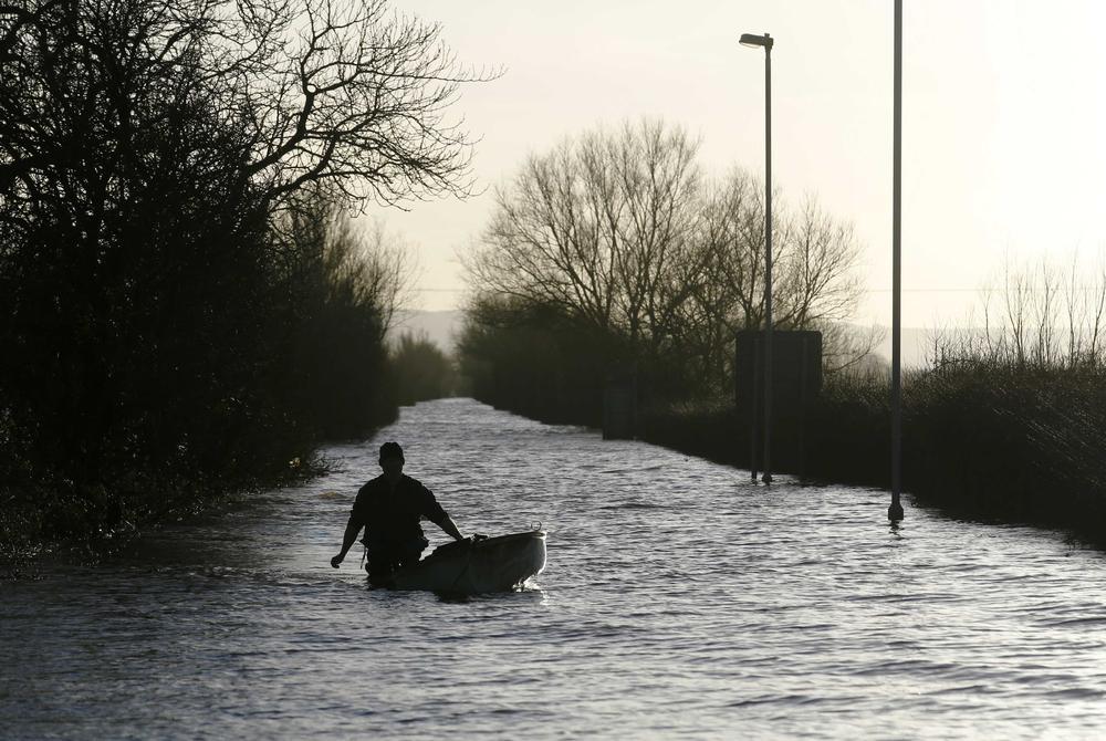 UK floods: Homes along Thames warned 'lives at risk' as rail passengers face misery