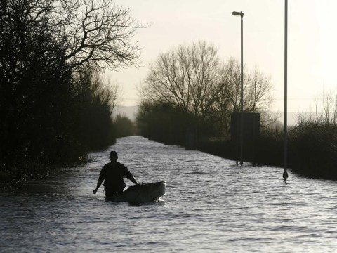 UK floods: Homes along Thames warned 'lives at risk' as rail passengers face misery