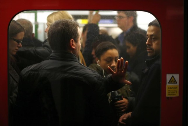 Commuters squeeze into a busy tube carriage during the evening rush hour on the second day of a strike by London Underground workers in central London, February 6, 2014. Commuters faced a reduced service on some lines, and none at all on others as the London Underground was affected by a 48 stoppage by unionized workers in protest at the proposed closure of all ticket offices. REUTERS/Andrew Winning (BRITAIN - Tags: BUSINESS EMPLOYMENT CIVIL UNREST) Andrew Winning/Reuters