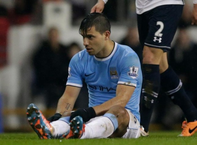 Sergio Aguero looks down before being substituted at Spurs (Picture: AP)