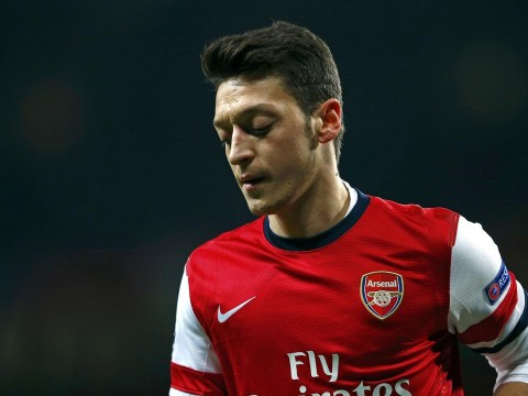 Police quiz Arsenal star Mesut Ozil 'after accident with photographer'