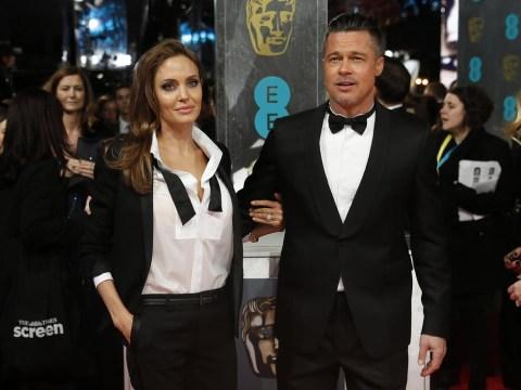 Baftas 2014: Angelina Jolie becomes Brad Pitt's stylist as she fixes his tuxedo collar