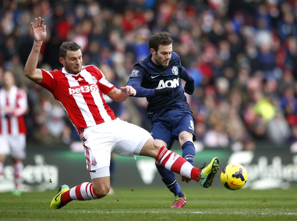 Juan Mata, Wayne Rooney and Robin van Persie fail to inspire Manchester United as Stoke stun Reds