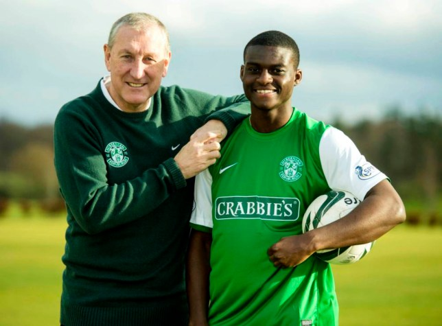 04/02/14 HIBERNIAN TRAINING CENTRE - EDINBURGH Hibernian manager Terry Butcher is all smiles as he unveils his new signing Daniel Boateng (right).