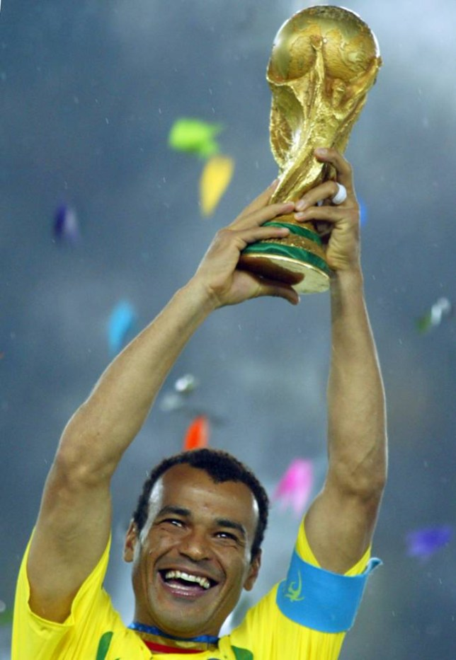 Brazil's team captain and defender Cafu hoists the World Cup trophy after Brazil won 2-0 against Germany in match 64 of the 2002 FIFA World Cup Korea Japan final 30 June, 2002 at the International Stadium Yokohama, Japan. Brazil has now won a record five World Cup titles.Brazil previously was a FIFA World Cup winner in 1958, 1962, 1970 and 1994. AFP PHOTO GABRIEL BOUYS (Photo credit should read GABRIEL BOUYS/AFP/Getty Images)