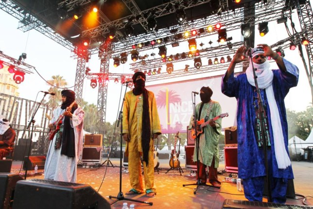 Abdallah Ag  Alhousseyni of Tinariwen (far right) says the group wants to visit every desert in the world (Picture: Valery Hache/AFP/Getty)