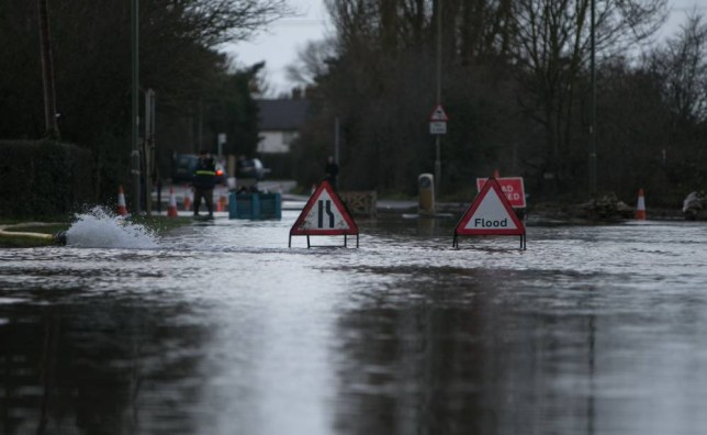A flooded road near Chertsey in Surrey as large swathes of England and Wales are on flood alert today as yet another storm with winds of up to 70mph arrives in Britain. PRESS ASSOCIATION Photo. Picture date: Saturday February 8, 2014. See PA story WEATHER Flood. Photo credit should read: Steve Parsons/PA Wire