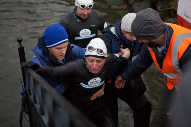 Handout photo issued by Sport Relief of Davina McCall on Day 3 of her Sport Relief Challenge is helped from the water as she completes her swim across Lake Windermere. PRESS ASSOCIATION Photo. Issue date: Monday February 10, 2014. On her seven day challenge she will run, swim and cycle from Edinburgh to London to raise money for Sport Relief. Photo credit should read: Lucille Flood/PA Wire NOTE TO EDITORS: This handout photo may only be used in for editorial reporting purposes for the contemporaneous illustration of events, things or the people in the image or facts mentioned in the caption. Reuse of the picture may require further permission from the copyright holder.
