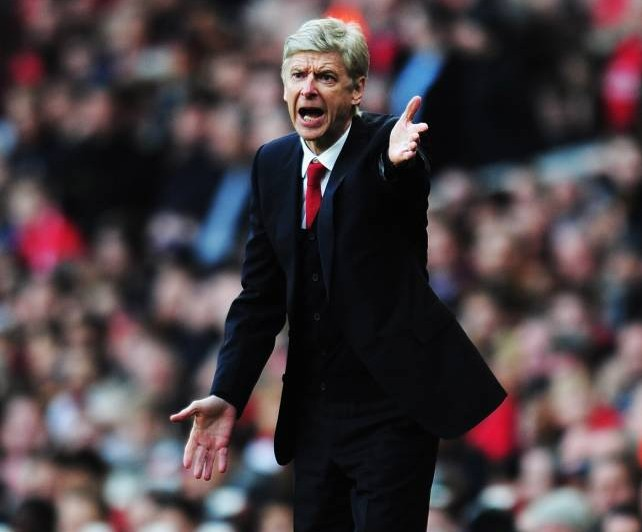 LONDON, ENGLAND - FEBRUARY 16:  Arsenal manager Arsene Wenger shouts instructions from the touchline during the FA Cup Fifth Round match between Arsenal and Liverpool at the Emirates Stadium on February 16, 2014 in London, England.  (Photo by Shaun Botterill/Getty Images)