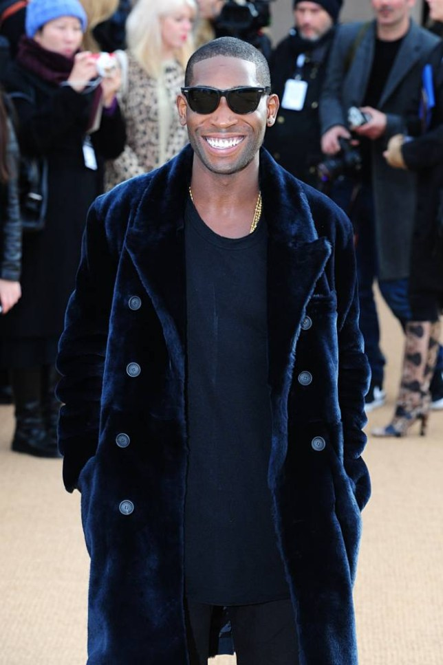Tinie Tempah arriving for the Burberry Prorsum autumn/winter 2014 London Fashion Week show at Kensington Gardens, London. PRESS ASSOCIATION Photo. Picture date: Monday February 17, 2014. Photo credit should read: Ian West/PA Wire