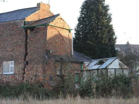 Huge crack destroys house after 25ft sinkhole appears