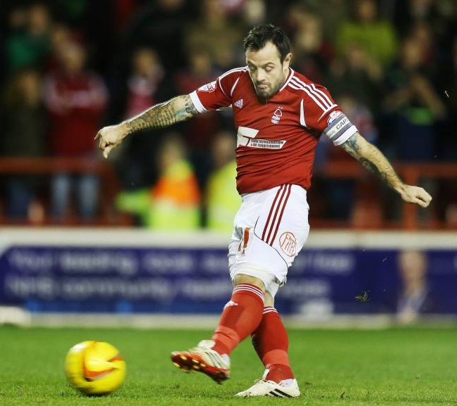 Nottingham Forest's Andy Reid shows Mesut Ozil and David Alaba how to take a penalty