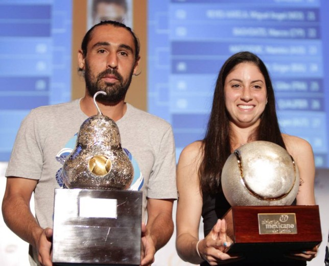 epa04098437 US Christina McHale (R) and Cypriot Marcos Baghdatis (L) pose for pictures with the trophies of the Mexican Open tennis tournament during a draw ceremony in Acapulco, Mexico, 23 February 2014. The tournament will take place in Acapulco from 24 February to 01 March.  EPA/JOSE MENDEZ