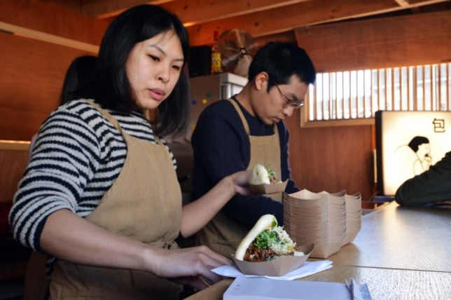 Siblings Wai-Ting and Shing Tat Chung serve gua bao from their food van (Picture: Daniel Lynch)