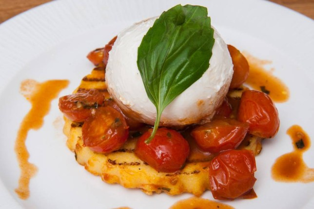 Polenta with burrata cheese and fresh chopped cherry tomatoes (Picture: G Mazzarini)