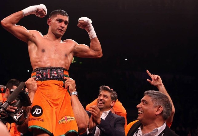 File photo dated 27/04/2013 of Amir Khan celebrating his points victory over Julio Diaz during the Welterweight bout at the Motorpoint Arena, Sheffield.
