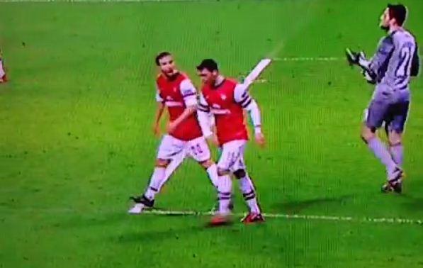 Mesut Ozil and Mathieu Flamini fight on pitch during Arsenal defeat to Bayern Munich