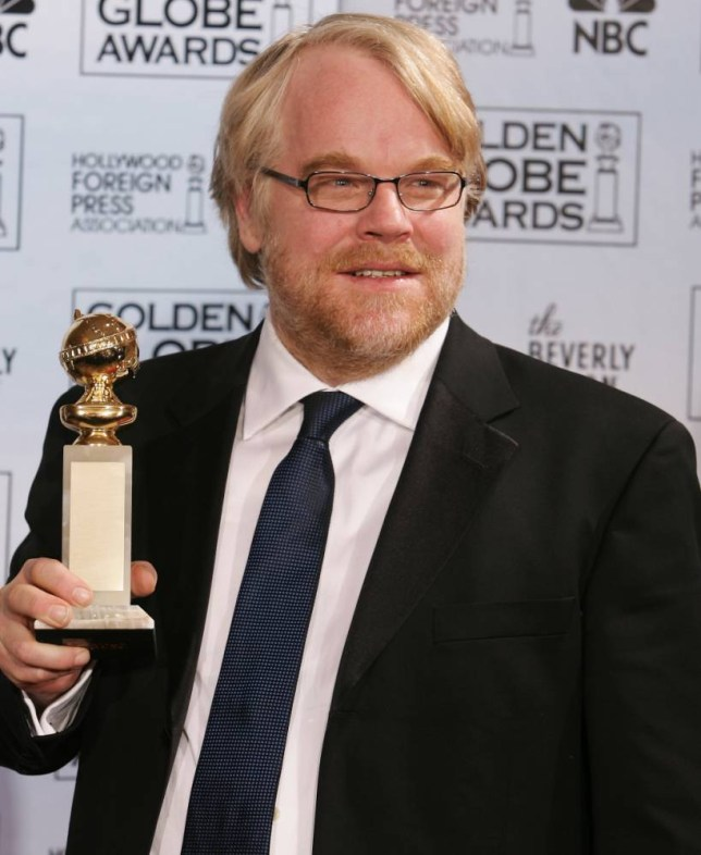 """Philip Seymour Hoffman poses with the award he won for best actor in a drama for his work in """"Capote,"""" at the 63rd Annual Golden Globe Awards on Monday, Jan. 16, 2006, in Beverly Hills, Calif.  (AP Photo/Reed Saxon)"""