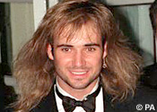 Andre Agassi - looking like a bloody fool with his mullet. You can win £100 if you send us your pic of yourself or others looking like a bloody fool with a mullet