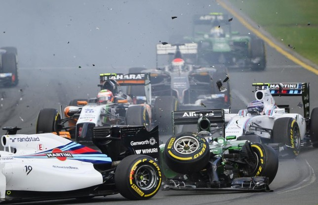Williams driver Felipe Massa of Brazil, left, and Caterham driver Kamui Kobayashi of Japan, right, collide on turn one in the first lap of the Australian Formula One Grand Prix at Albert Park in Melbourne, Australia, Sunday, March 16, 2014. Both Massa and Kobayashi walked away from the accident. (AP Photo/Ross Land) AP Photo/Ross Land