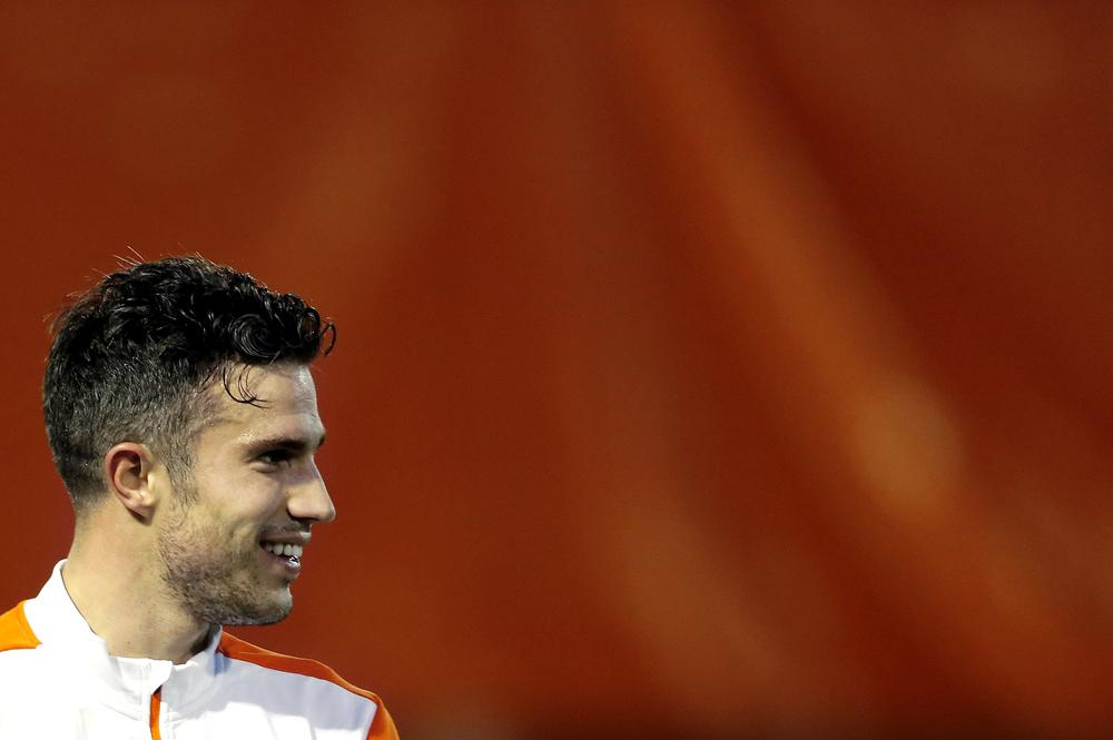 Tekkers! Robin van Persie scores past Michel Vorm with outrageous nutmeg in Holland training