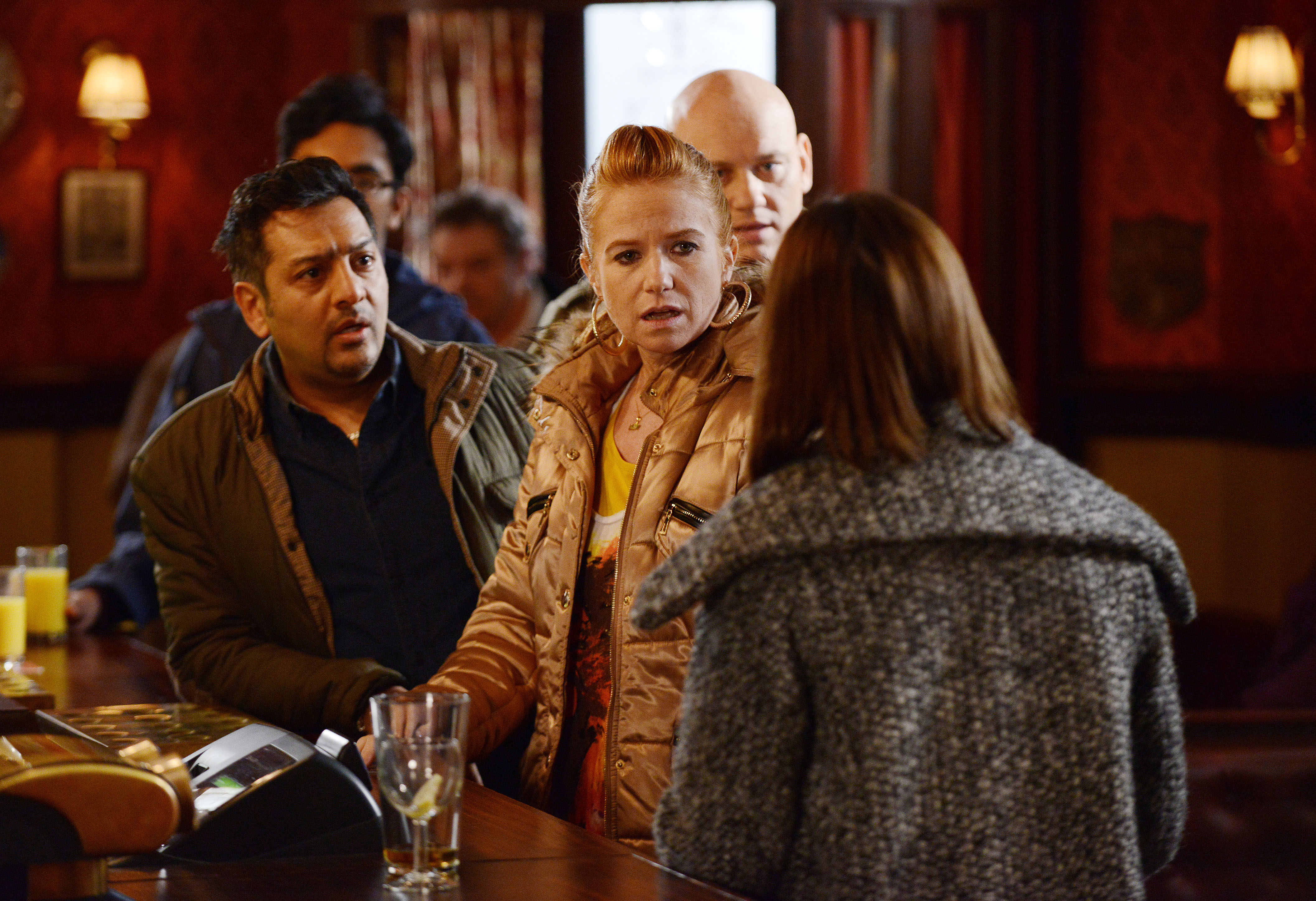 WARNING: Embargoed for publication until: 11/03/2014 - Programme Name: EastEnders - TX: 20/03/2014 - Episode: Eastenders - 4823 (No. 4823) - Picture Shows: The customers in The Vic discover the verdict of the trial. Masood Ahmed (NITIN GANATRA), Bianca Butcher (PATSY PALMER), Sonia Fowler (NATALIE CASSIDY) - (C) BBC - Photographer: Steve Peskett