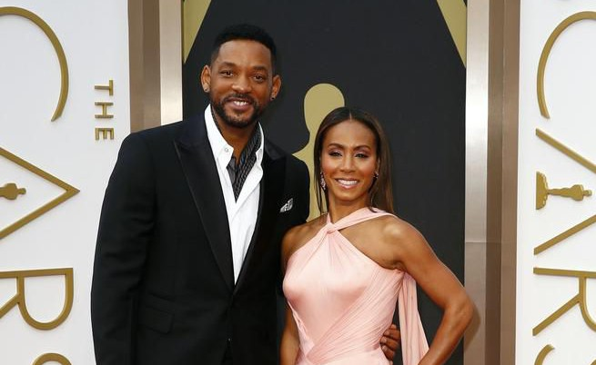 Actor Will Smith and wife Jada Pinkett Smith arrive at the 86th Academy Awards in Hollywood, California March 2, 2014. REUTERS/Lucas Jackson (UNITED STATES TAGS: ENTERTAINMENT) (OSCARS-ARRIVALS) Lucas Jackson/Reuters