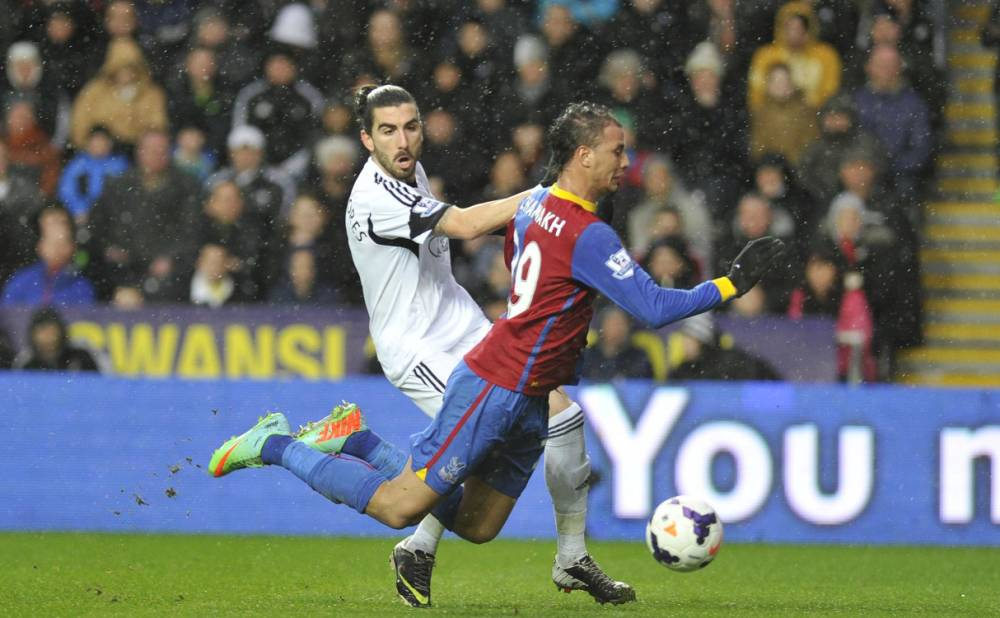 Swansea City' Chico Flores (left) and Crystal Palace's Marouane Chamakh during the Barclays Premier League match at the Liberty Stadium, Swansea. PRESS ASSOCIATION Photo. Picture date: Sunday March 2, 2014. See PA story SOCCER Swansea. Photo credit should read: PA Wire. RESTRICTIONS: Editorial use only. Maximum 45 images during a match. No video emulation or promotion as 'live'. No use in games, competitions, merchandise, betting or single club/player services. No use with unofficial audio, video, data, fixtures or club/league logos.