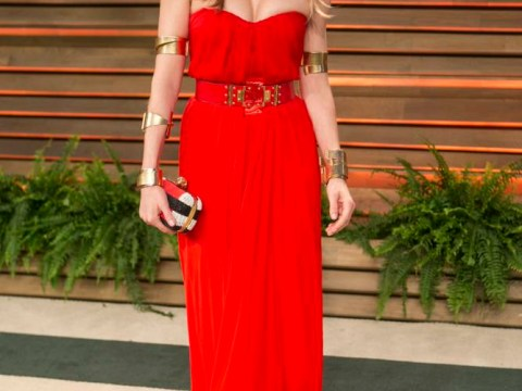 One is never enough: Sienna Miller takes inspiration from She-Ra with plenty of bling for her Oscars party dress