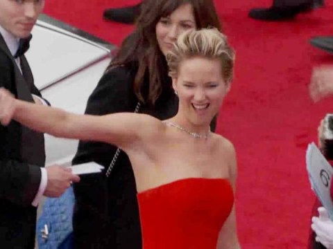 She's done it again! Jennifer Lawrence falls over on Oscars red carpet – but this time she's saved by Nicholas Hoult