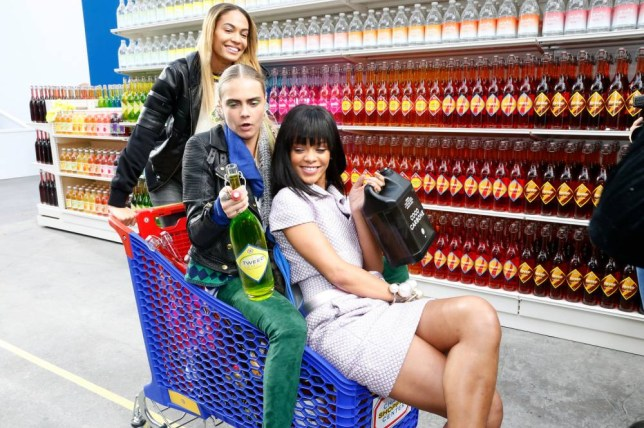 Rihanna and Cara Delevingne take part in a trolley dash at the Lagerfeld show