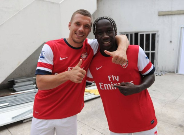 LAGOS, NIGERIA - JULY 29: Lukas Podolski and Bacary Sagna of Arsenal FC takes part in an Airtel promotional activity on July 29, 2012 in Lagos, Nigeria. (Photo by David Price/Arsenal FC via Getty Images)