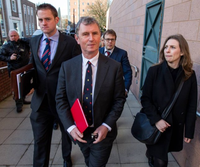 Accused: Nigel Evans, centre, arrives at Preston crown court yesterday. He denies raping a student at his home after the  22-year-old spurned his advances Picture: LNP