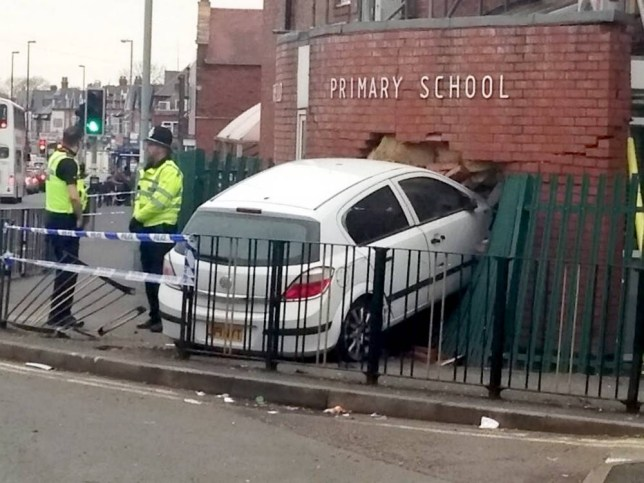 A white Vauxhall Astra is embedded into Springfield Primary School in Moseley, Birmingham after crashing this morning March 10, 2014. See NTI story NTICRASH.  A careless driver had a lucky escape yesterday (Mon) when they careered off the road and crashed into a SCHOOL wall.  Shocking pictures show the white Vauxhall Astra embedded in the bricked entrance to Springfield Primary School in Moseley, Birmingham.  The front bonnet of the car - which ploughed through a green metal fence before hitting the wall - is completely covered by bricks.  Police are now investigating the crash and are trying to trace the occupants of the Astra - who are believed to have fled after the collision at 5am.  No-one was injured but the school remained closed yesterday as structural engineers assessed the damage.