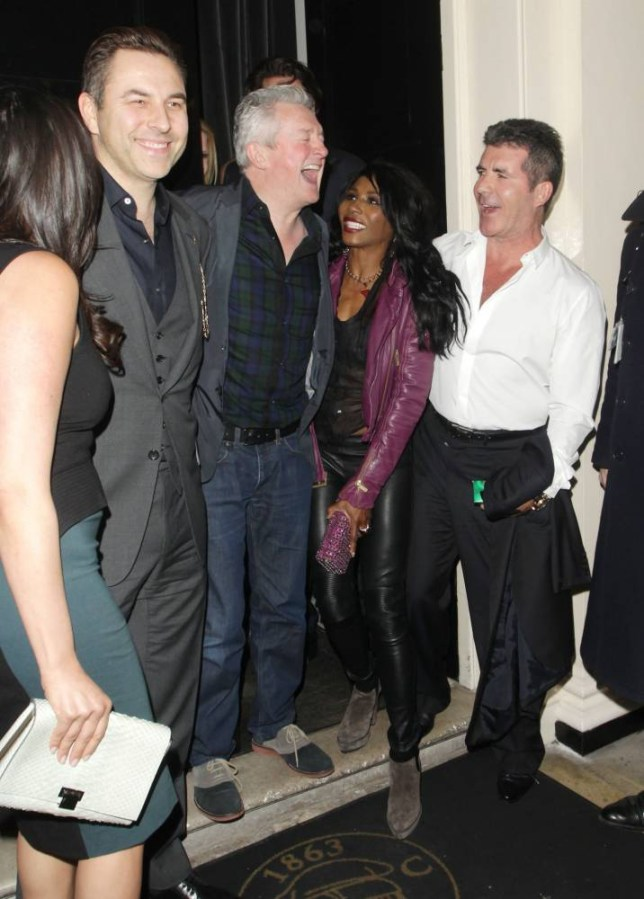 11 MARCH 2014 - LONDON - UK SIMON COWELL AND FRIENDS AT THE ARTS CLUB TO WET THE BABYS HEAD X FACTOR JUDGE SIMON COWELL PICTURED WITH PARTNER LAUREN SILVERMAN AND FRIENDS LOUIS WALSH, SINITTA AND DAVID WALLIAMS WITH HIS WIFE LARA STONE AS THEY LEAVE THE ARTS CLUB IN MAYFAIR AFTER ENJOYING A NIGHT OUT TOGETHER! BYLINE MUST READ : XPOSUREPHOTOS.COM ***UK CLIENTS - PICTURES CONTAINING CHILDREN PLEASE PIXELATE FACE PRIOR TO PUBLICATION *** **UK CLIENTS MUST CALL PRIOR TO TV OR ONLINE USAGE PLEASE TELEPHONE 44 208 344 2007**