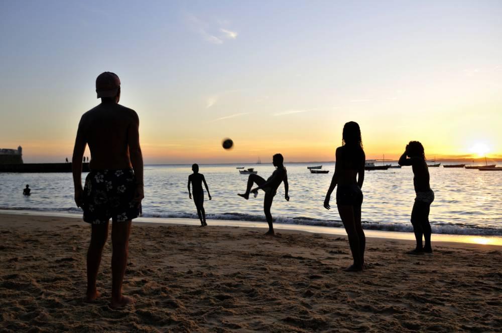 Football at sunset on the beach of Porto da Barra, Salvador, Bahia, Brazil (Picture: Alamy)