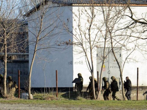 'War crime' as Russians kill Ukrainian soldier and wound another at military base in Crimea
