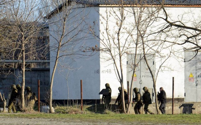 Armed Russian forces take part in a military operation at a Ukrainian military base in Simferopol (PIcture: AFP/Getty)